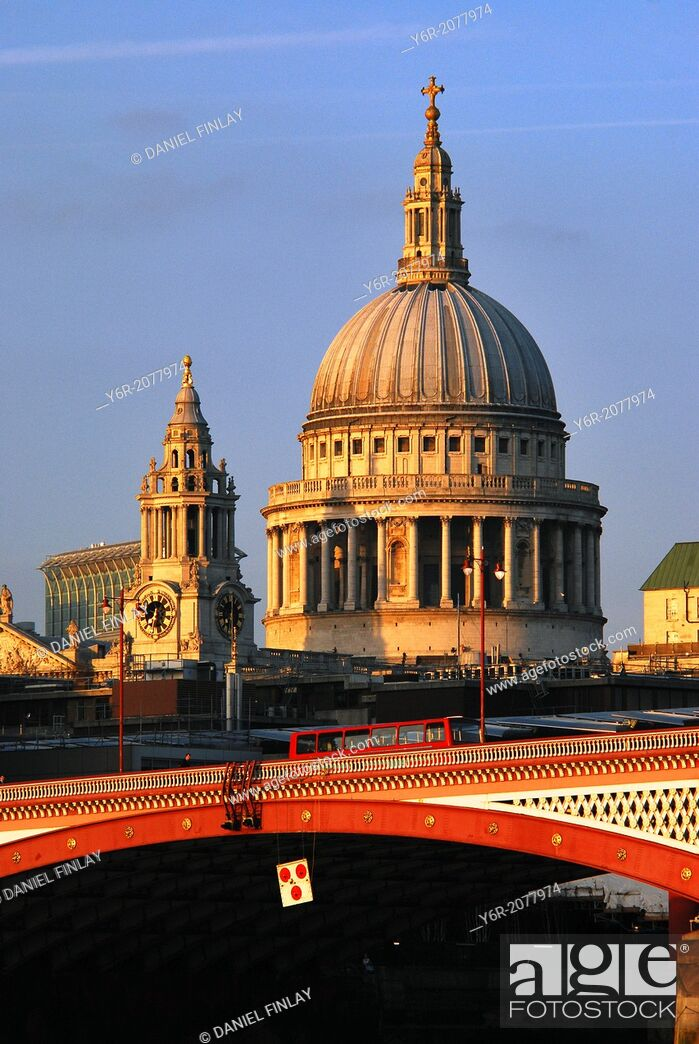 Stock Photo: St. Paul's Cathedral in the heart of London, England, with Blackfriar's Bridge over the River Thames in the foreground, lit up by warm late evening light.