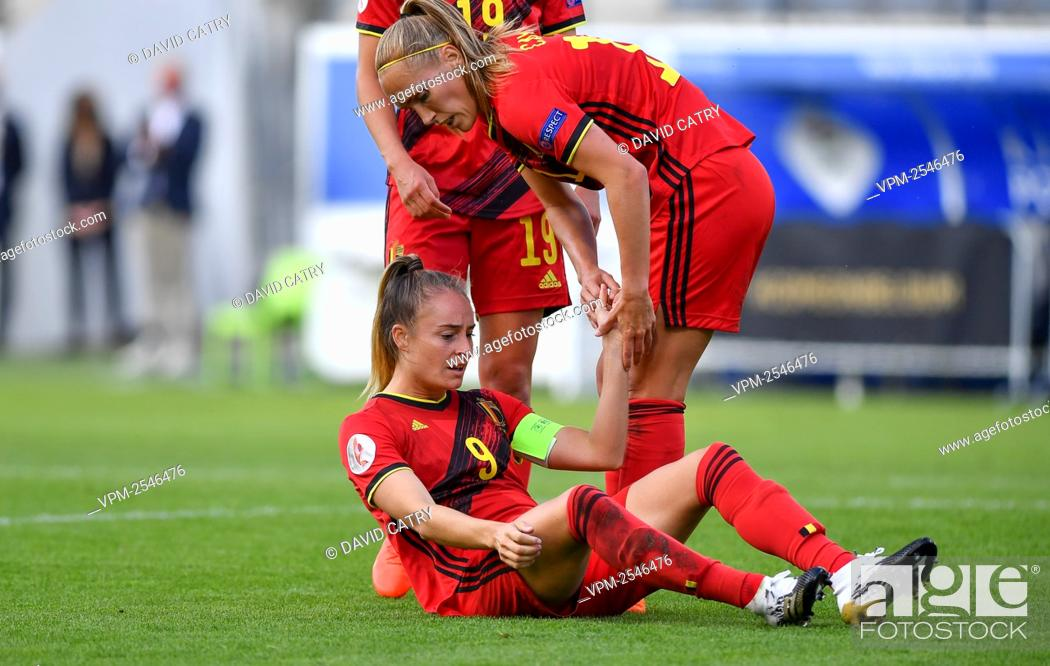 Stock Photo: Belgium's Tessa Wullaert celebrates after scoring, with Belgium's Janice Cayman during a soccer game between Belgium's Red Flames and Romania.