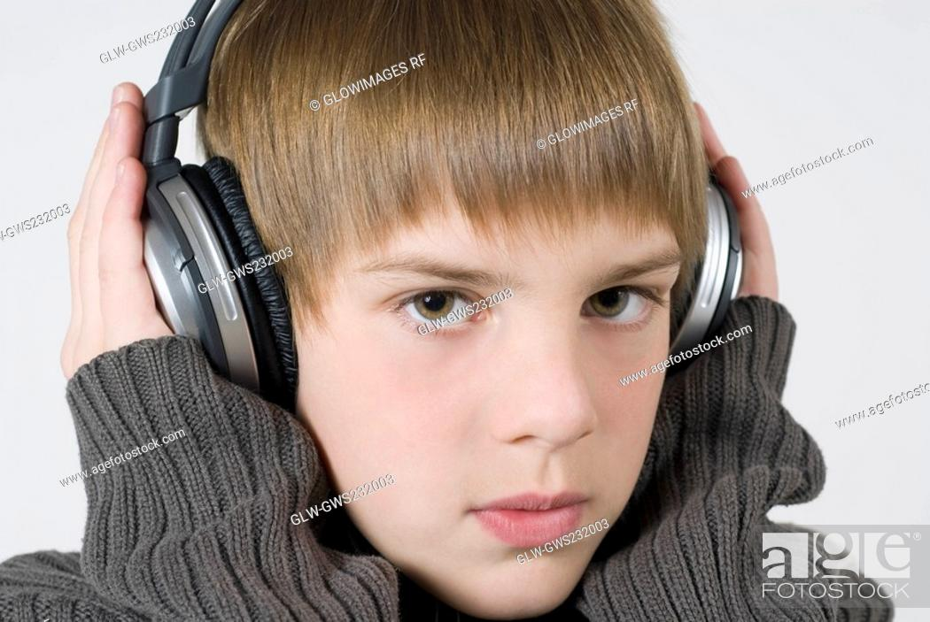 Stock Photo: Close-up of a boy listening to music.