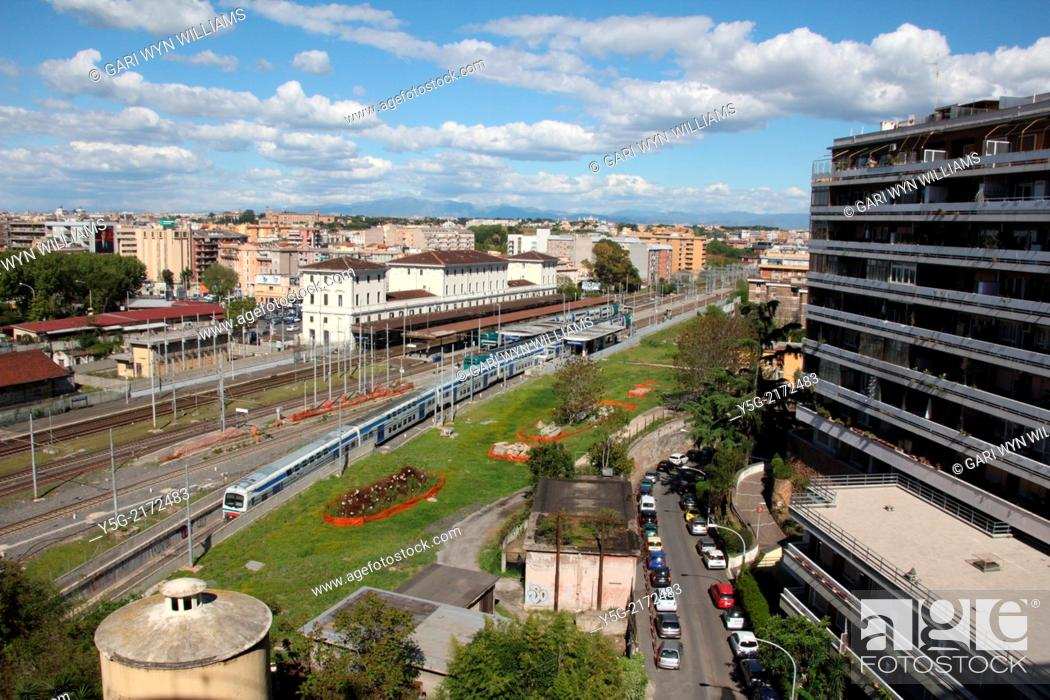 Stock Photo: Rome, Italy. 16th April 2014. The extremely cold northerly tramontana wind clears the sky over Trastevere Station in Rome, Italy.