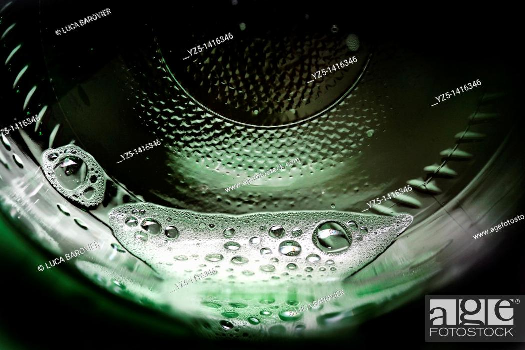 Stock Photo: A macro shot of bottom of a bottle of beer.
