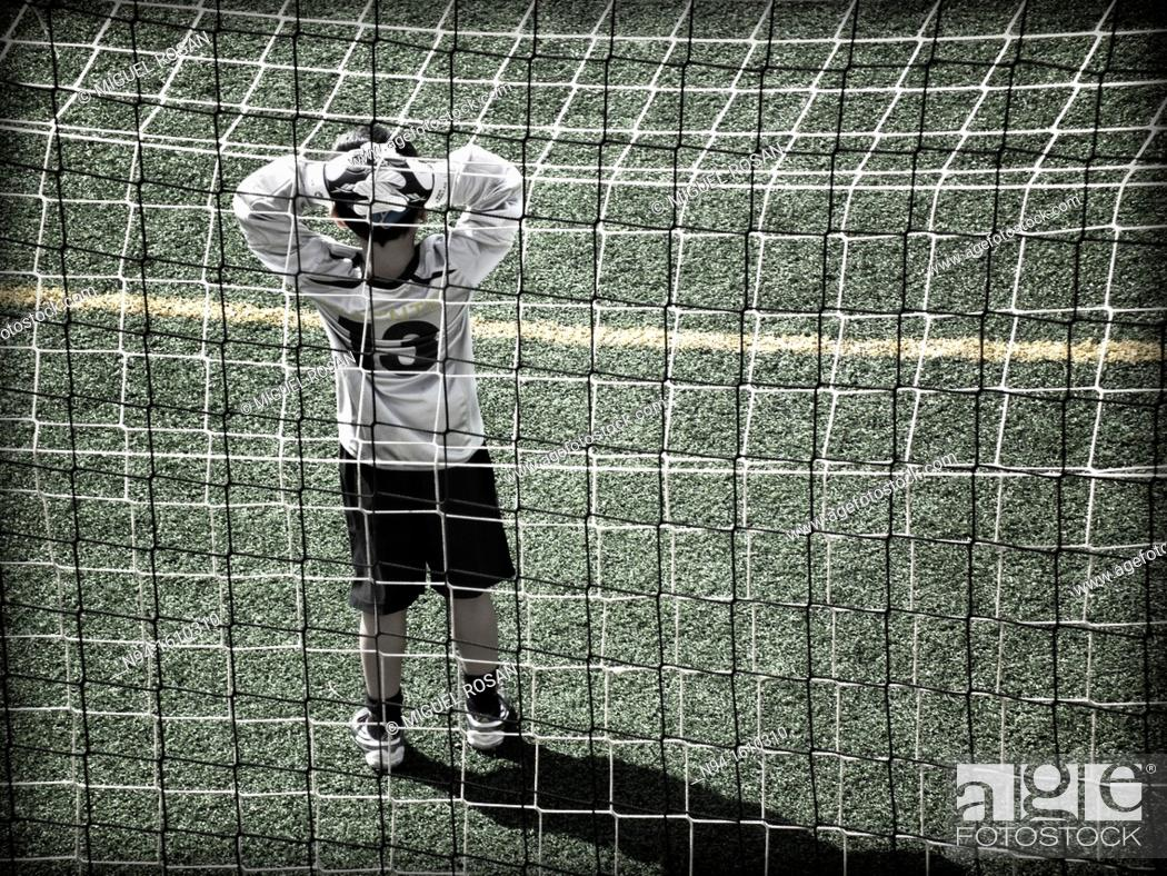 Stock Photo: Soccer goalie during a game in a child meeting.