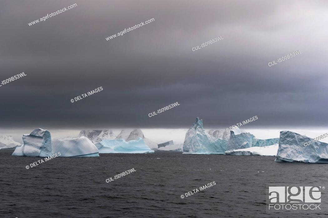 Stock Photo: Icebergs under a stormy sky, Lemaire channel, Antarctica.