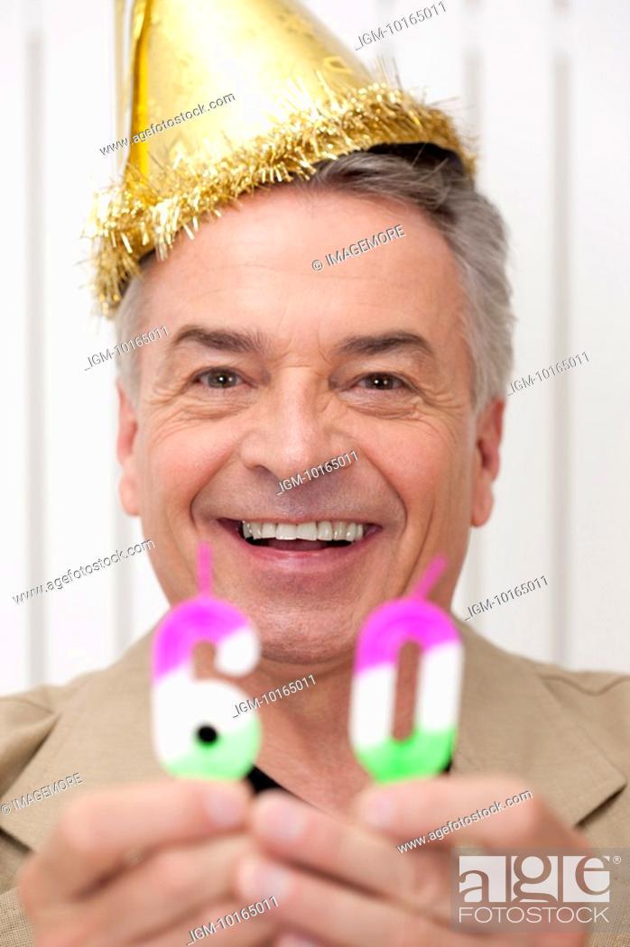 Stock Photo: Domestic Life, a senior man celebrating his sixty birthday.