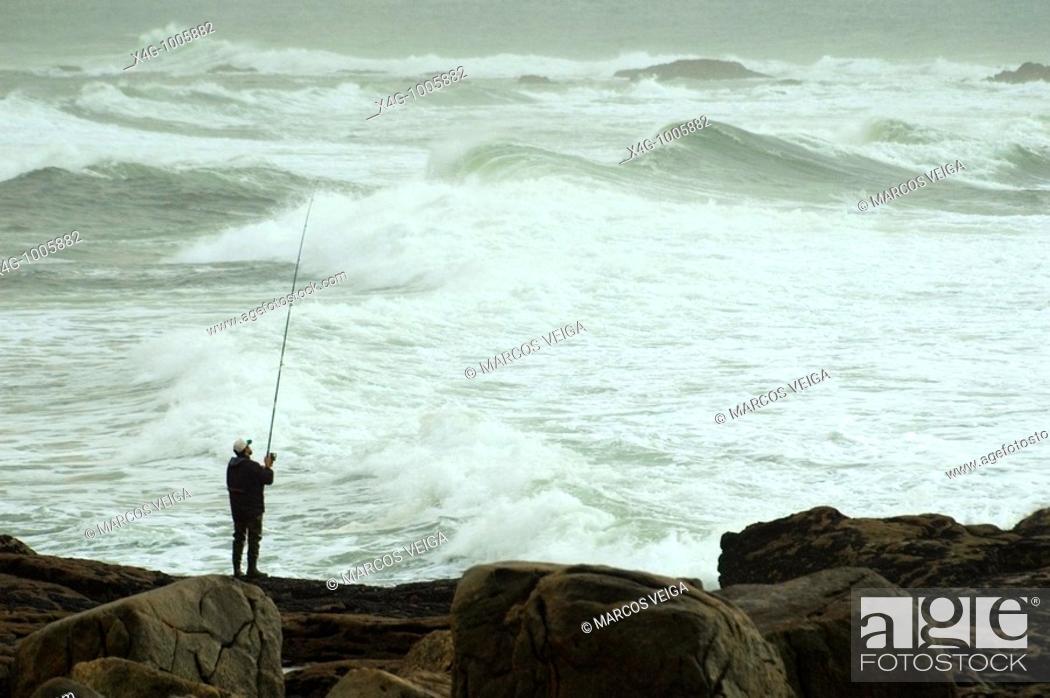 Stock Photo: Pescador en la costa, Angler at sea shore, A Guardia, Pontevedra, España.