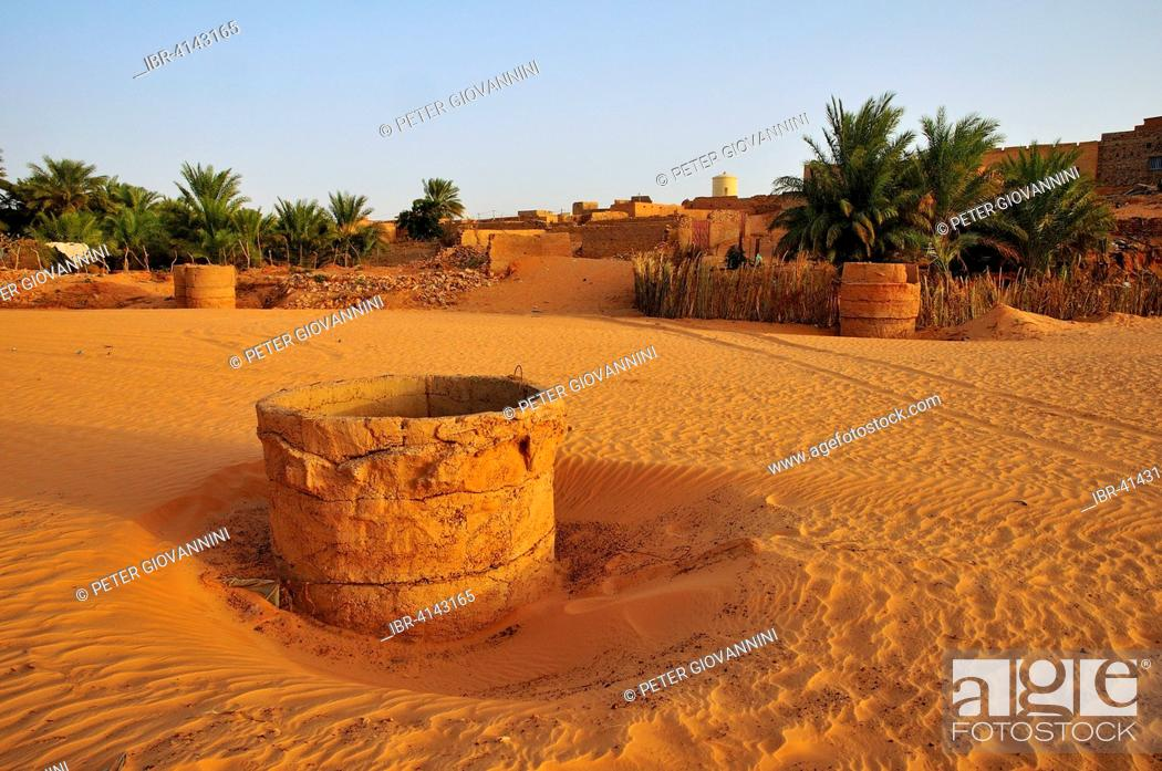 Stock Photo: Fountain in a dry riverbed, Wadi or Oued, in the evening light, Chinguetti, Adrar Region, Mauritania.