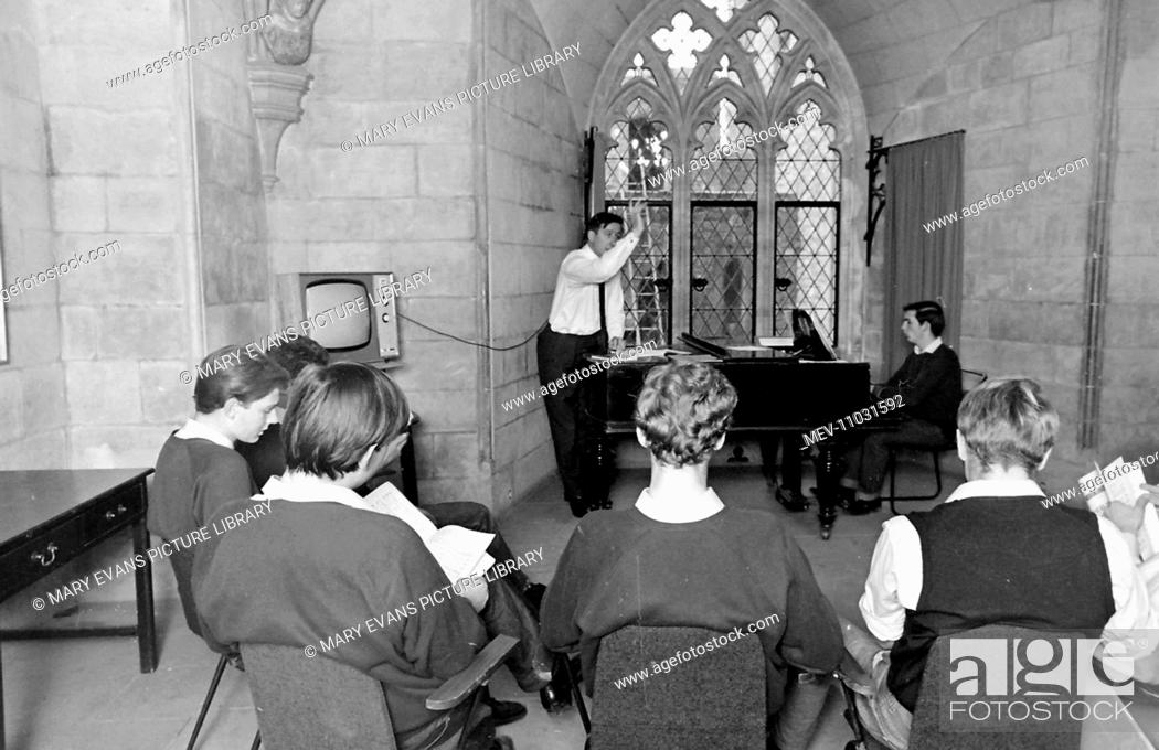 Stock Photo: Schoolboys and a teacher at work in a singing class at Atlantic College (United World College of the Atlantic), St Donat's Castle, Llantwit Major, Glamorgan.