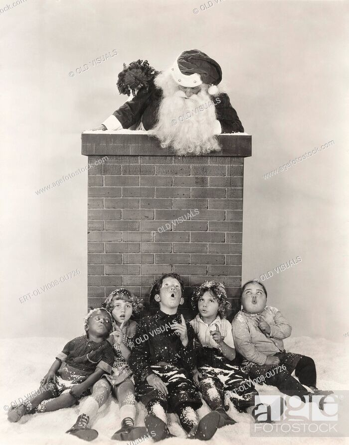 Stock Photo: Children sitting against chimney looking at Santa Claus.