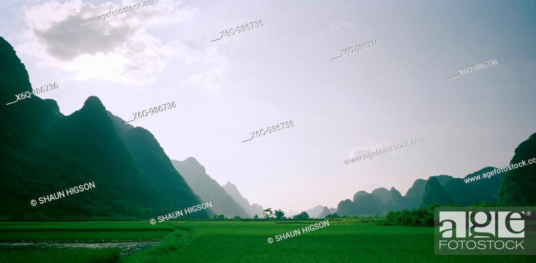 Stock Photo: A valley in the Guangxi countryside with the Guilin mountains in China in Asia Far East.