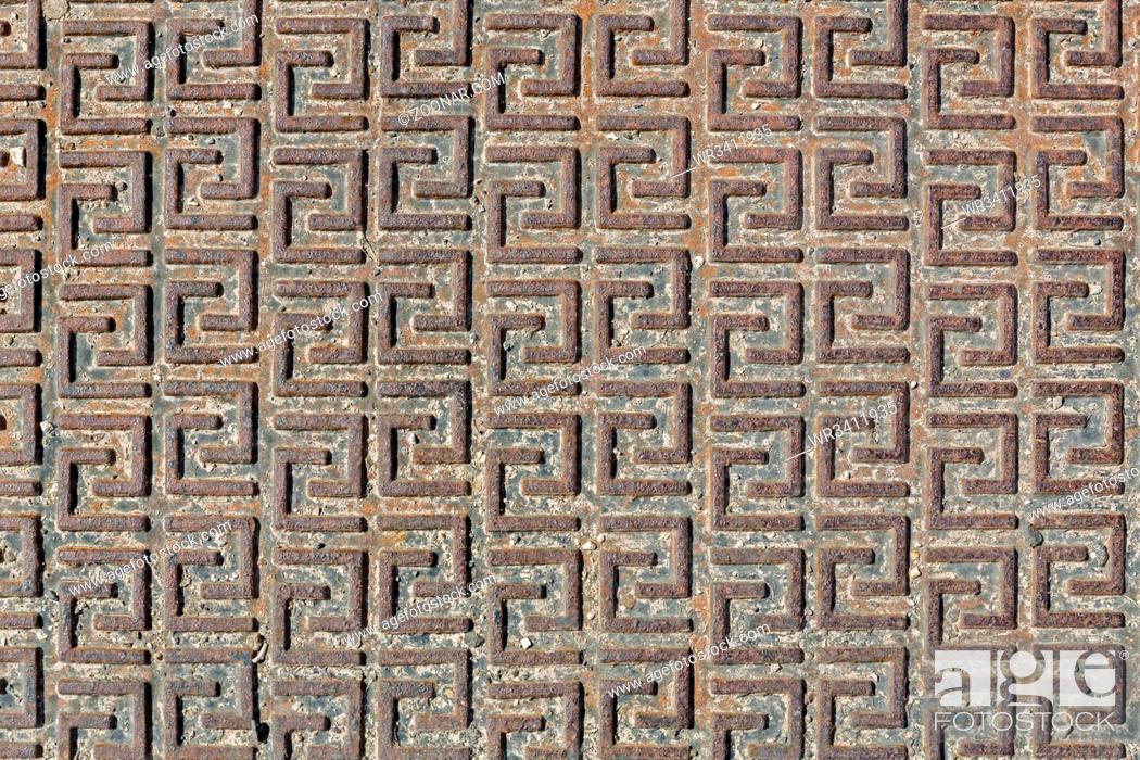 Stock Photo: Rostige Eisenplatte mit Muster als Hintergrund.