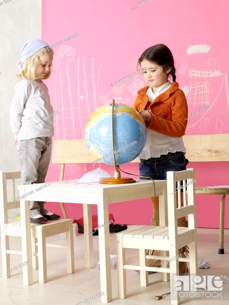 Stock Photo: Two girls with a globe.