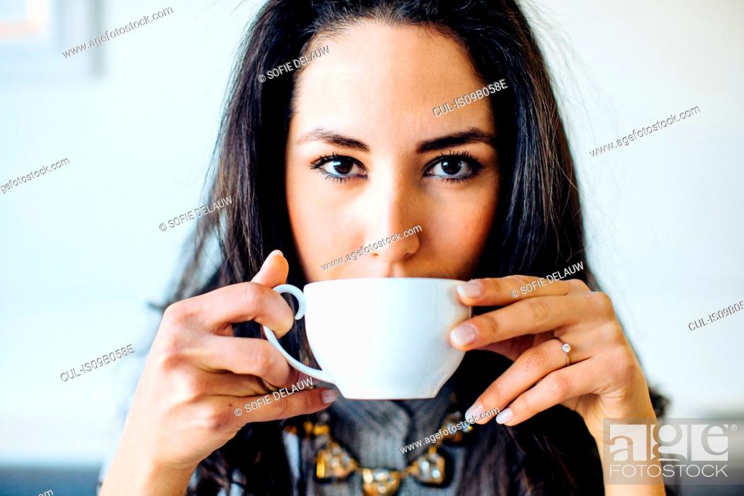 Stock Photo: Portrait of young woman drinking coffee in boutique hotel in Italy.