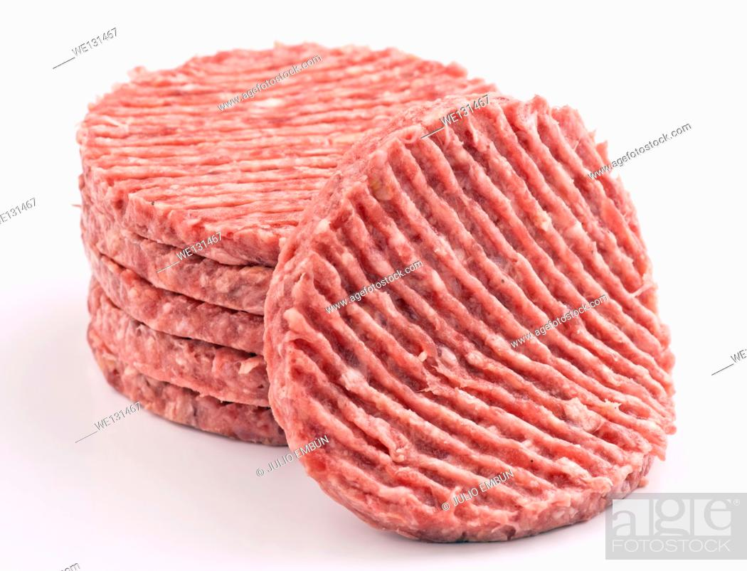Stock Photo: stacked raw hamburger steaks.