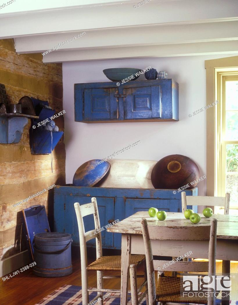Stock Photo Dining Rooms Log Cabin Exposed Painted White Beams Distressed Primitive Blue Dry Sink With Large Wooden Bowls Hanging