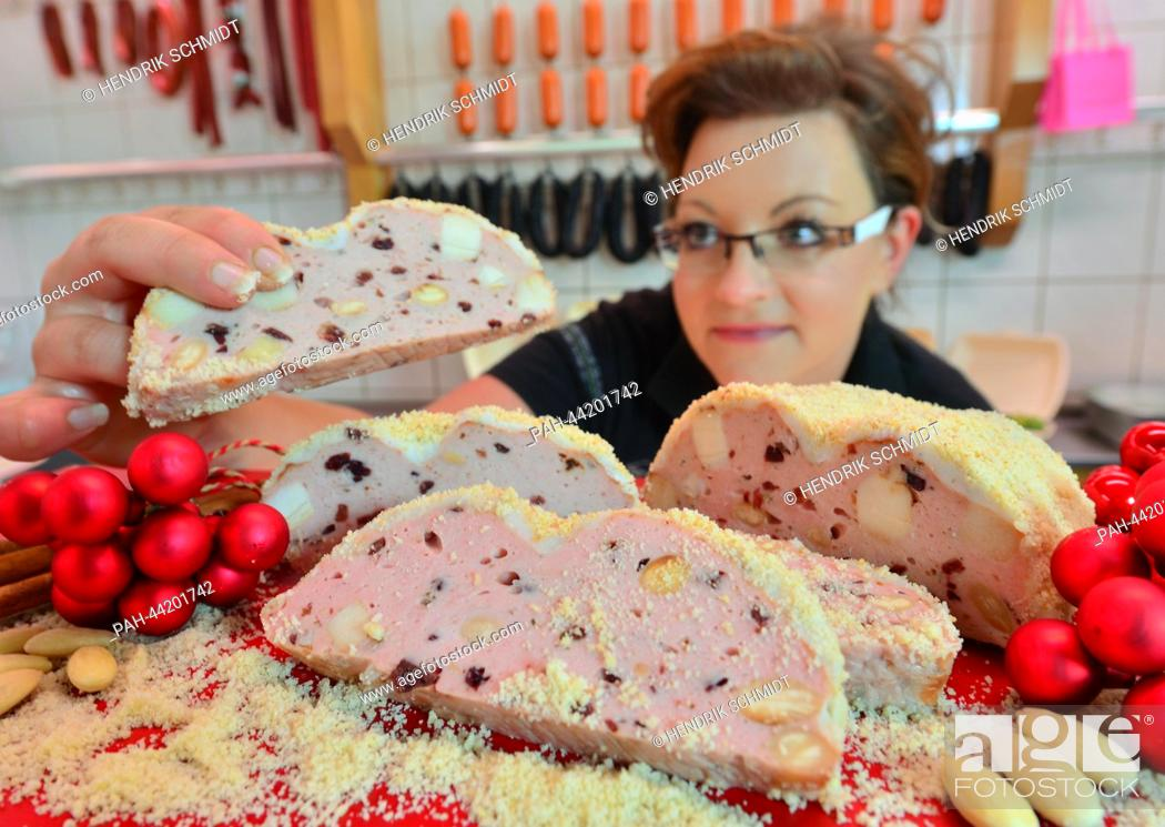 Stock Photo: In time for the Christmas season master butcher Christin Popella presents her sausage stollen in Aue, Germany, 19 November 2013.