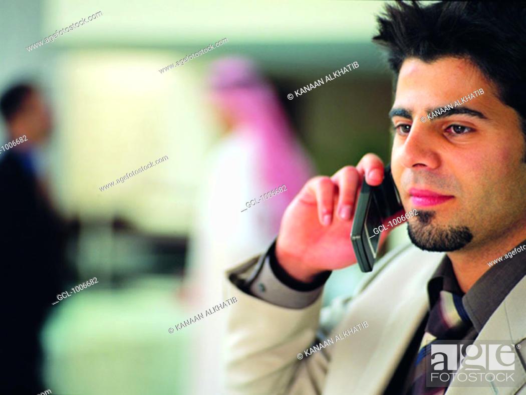 Stock Photo: Arab businessman using mobile phone.