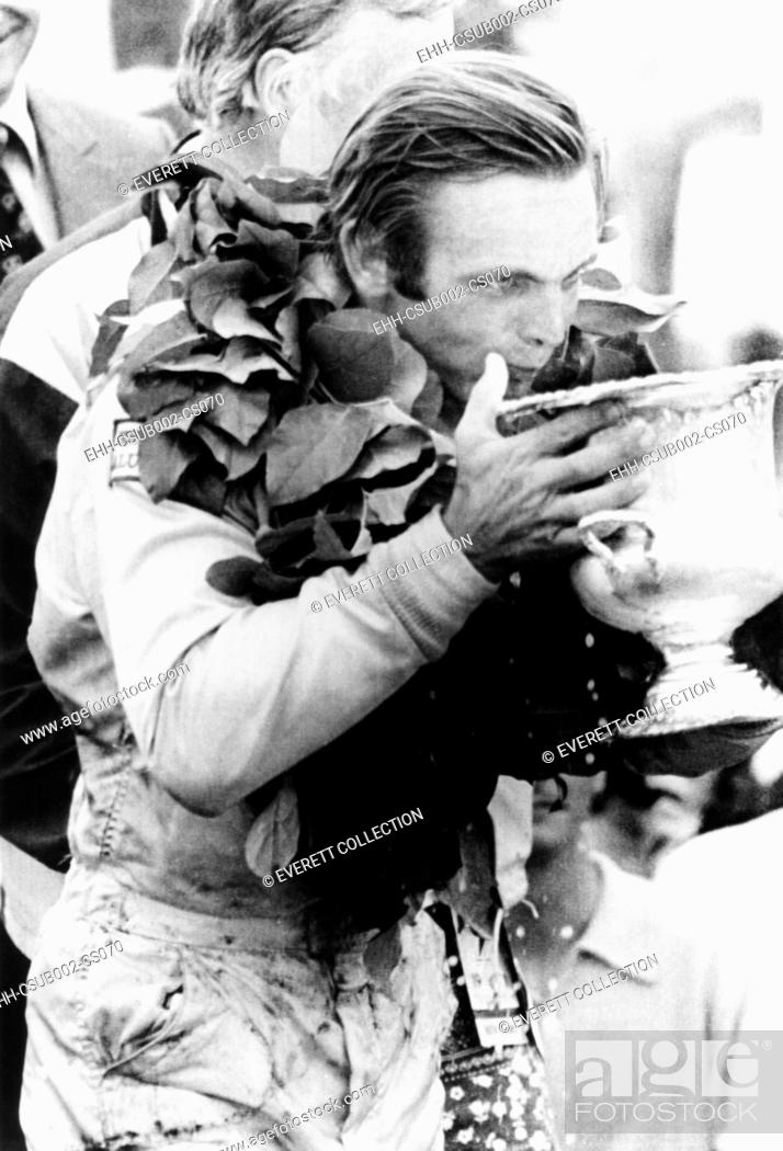 Stock Photo: Peter Revson drinks from his trophy after winning the Canadian-American championship. Watkins Glenn, NY, July 25, 1971. He averaged a speed of 128.
