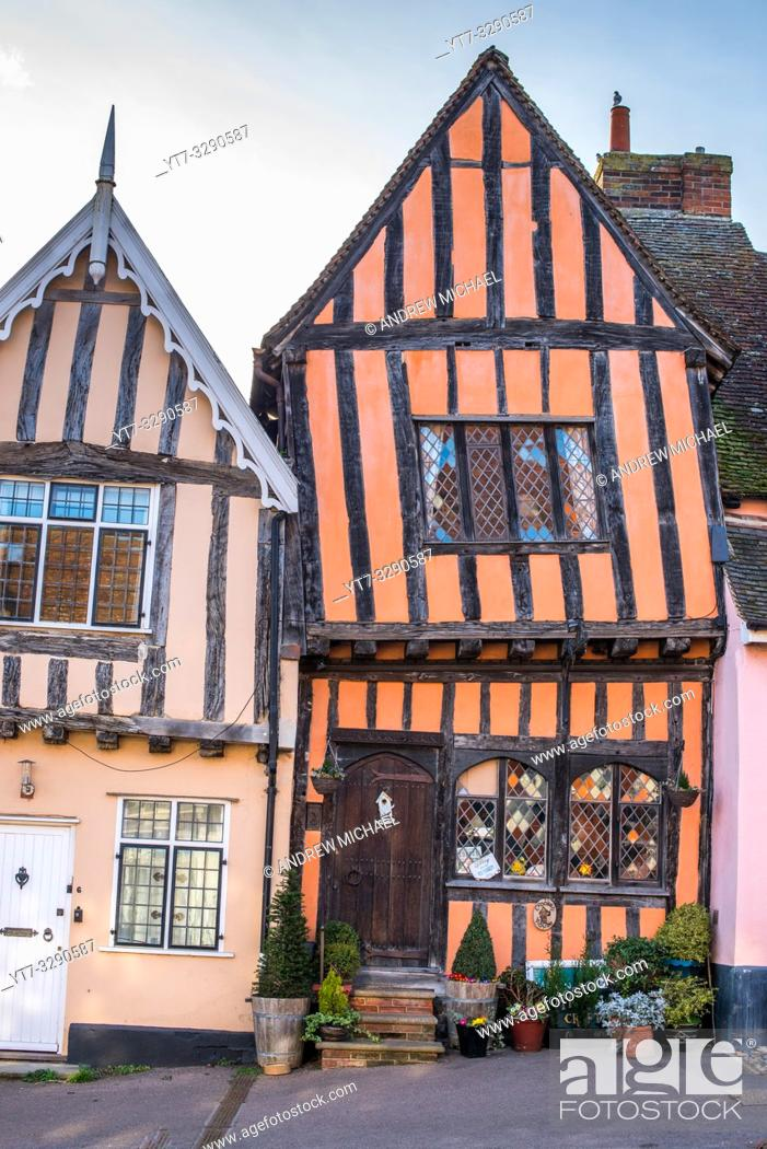 Stock Photo: 15th century Crooked House antiques shop and tearooms in quaint wonky crooked orange timbered building in High Street, Lavenham, Suffolk, England, UK.