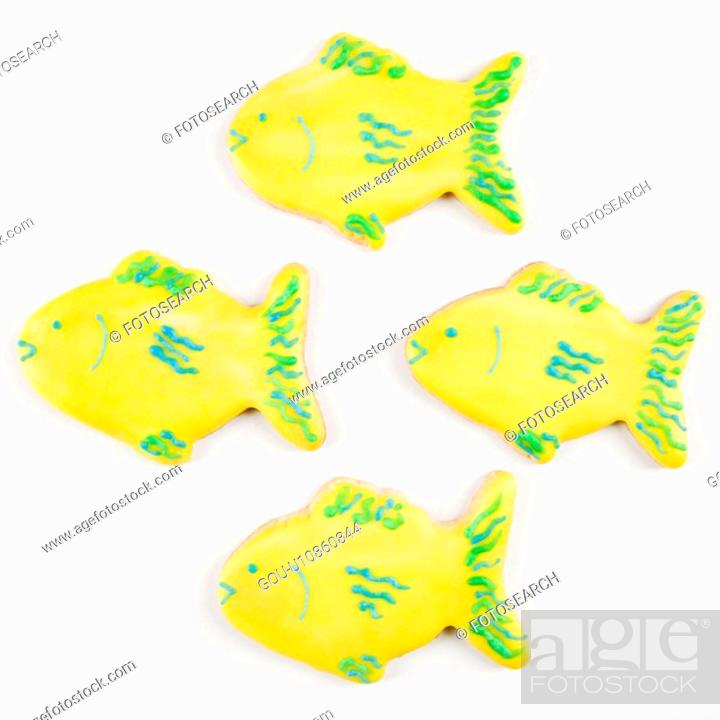 Stock Photo: Four fish shaped sugar cookies with decorative icing.