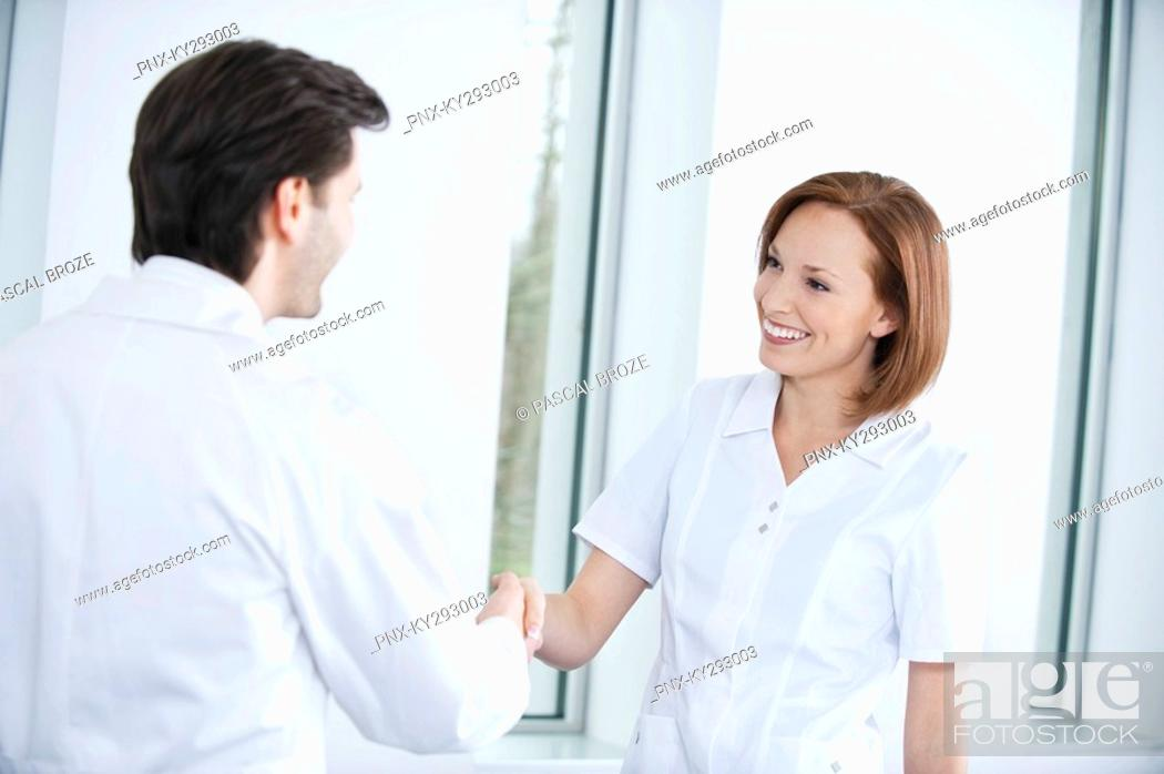 Stock Photo: Two doctors shaking hands.
