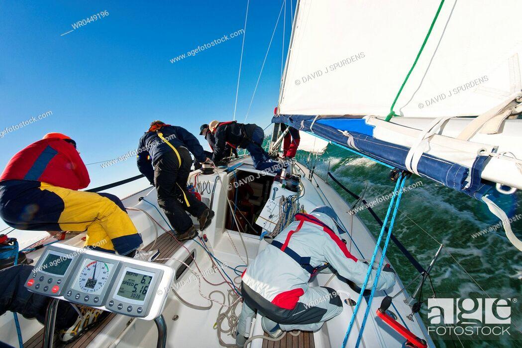Stock Photo: A yacht crew racing an ocean going yacht.