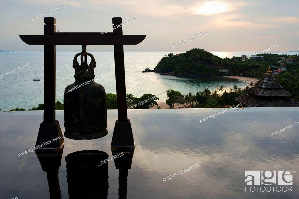 Stock Photo: Bell at Pool of luxury hotel Pimalai Resort, Kantiang Beach, Ko Lanta or Koh Lanta island, Krabi, Thailand, Asia. Pimalai Resort & Spa is a luxury beach resort.
