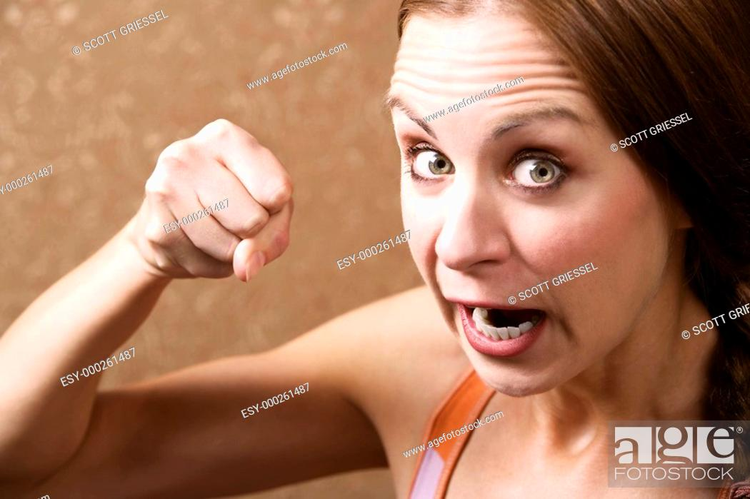 Stock Photo: Angry Woman Throwing a Punch.