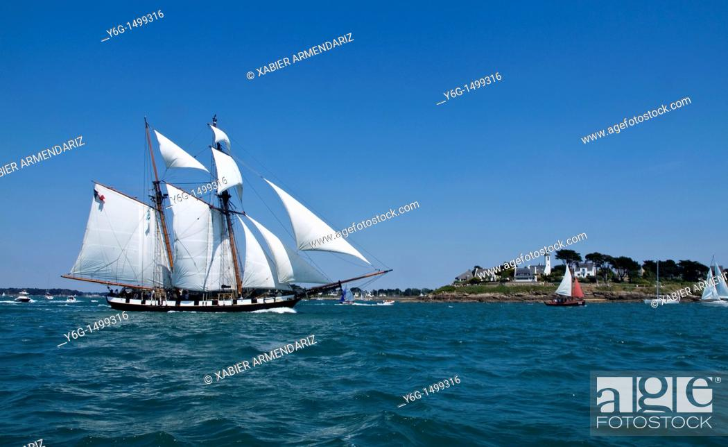 Stock Photo: Ancient schooner sailing near a lighthouse, Bay of Morbihan, Birttany, France, Europe.