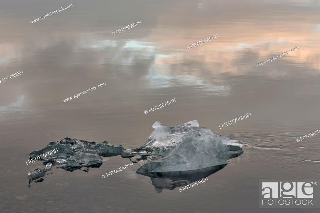 Stock Photo: Iceberg detail with reflection, Jokulsarlon lagoon sunrise, Icel.