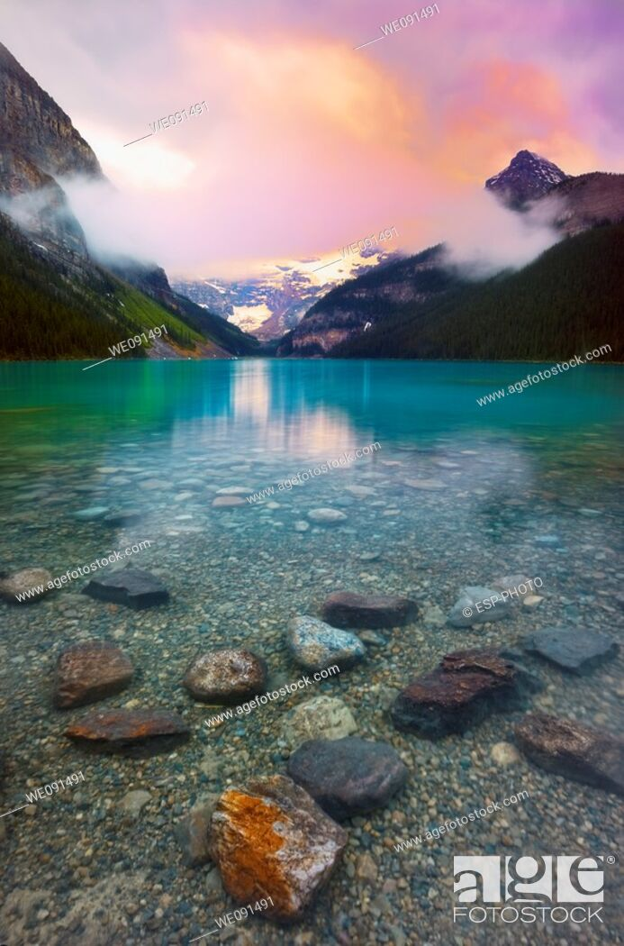 Stock Photo: Sunrise on Victoria Glacier Lake Louise, Banff National Park, Alberta, Canada.