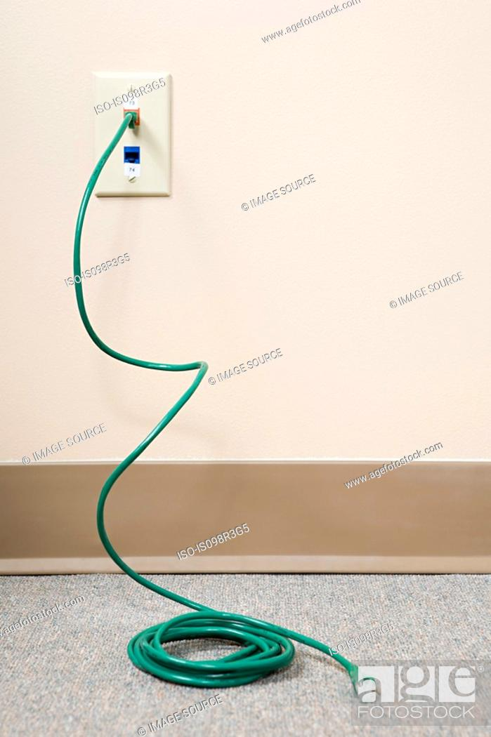 Stock Photo: Power cable coming out of socket.