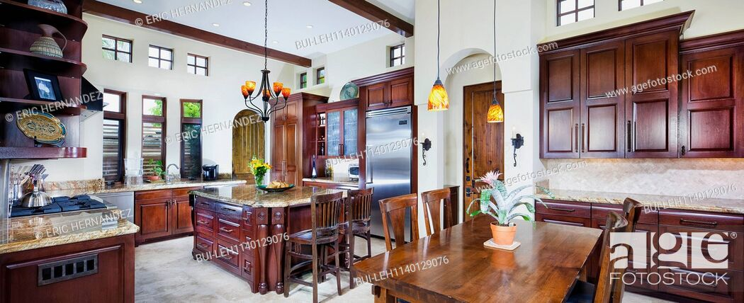 Imagen: Dining area in kitchen with brown cabinets at home; Dana Point; California; USA.