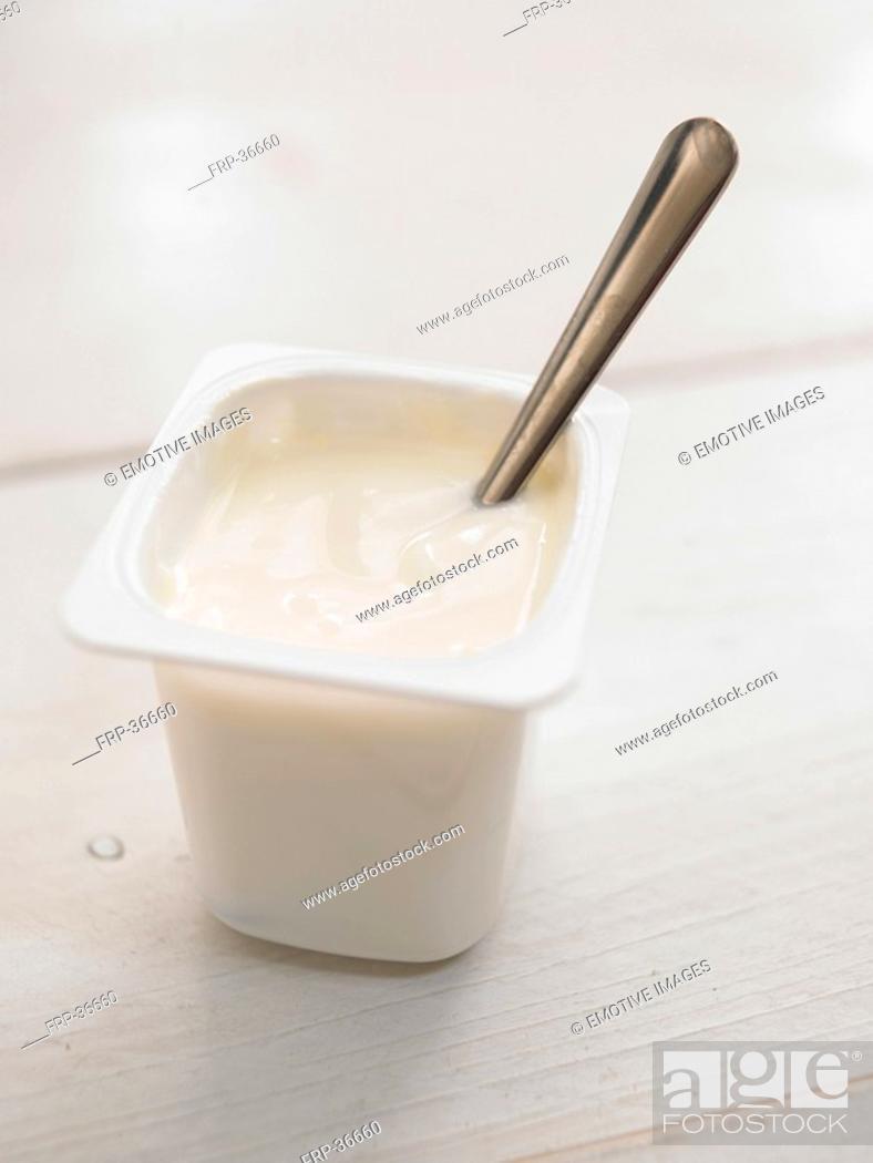Stock Photo: yogurt with spoon.