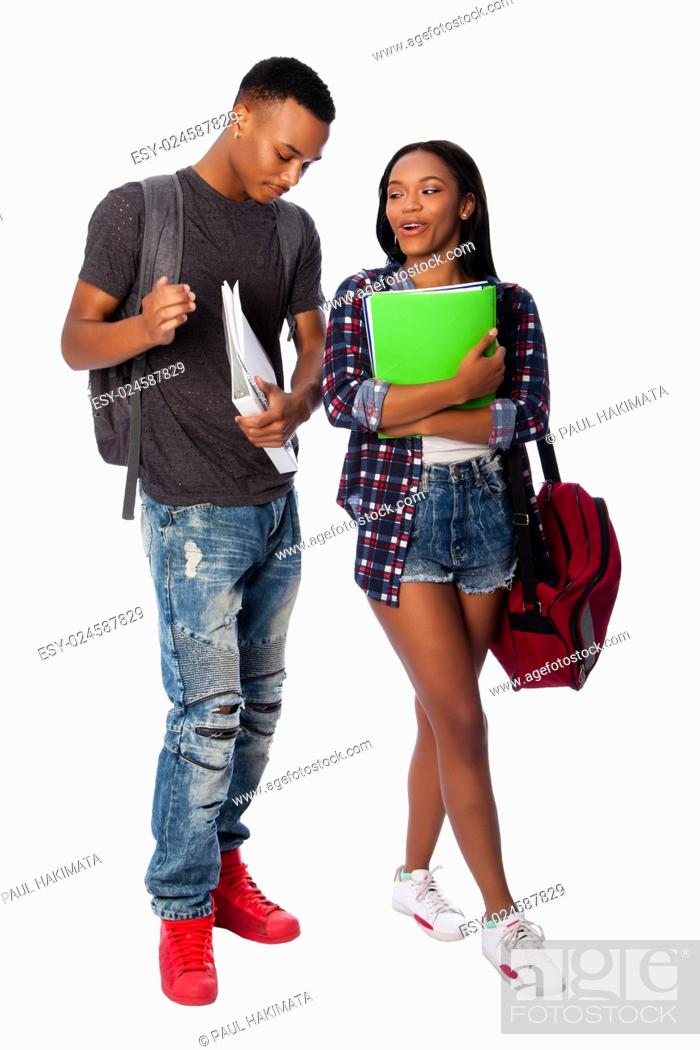 Stock Photo: Happy smiling students standing together having fun talking joking carrying book bag backpack notepads, on white.