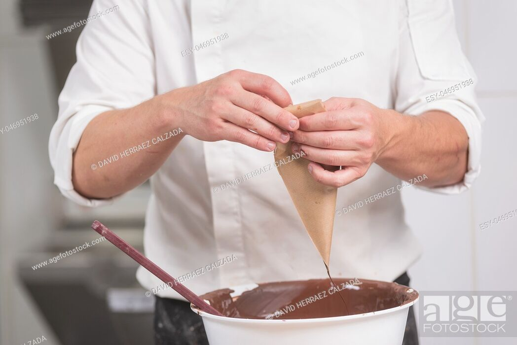Stock Photo: Professional confectioner making chocolate sweets at confectionery shop .