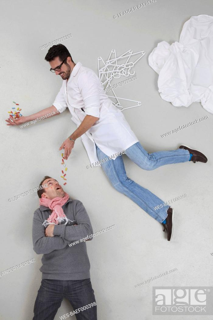 Stock Photo: Doctor giving medicine to sick patient.