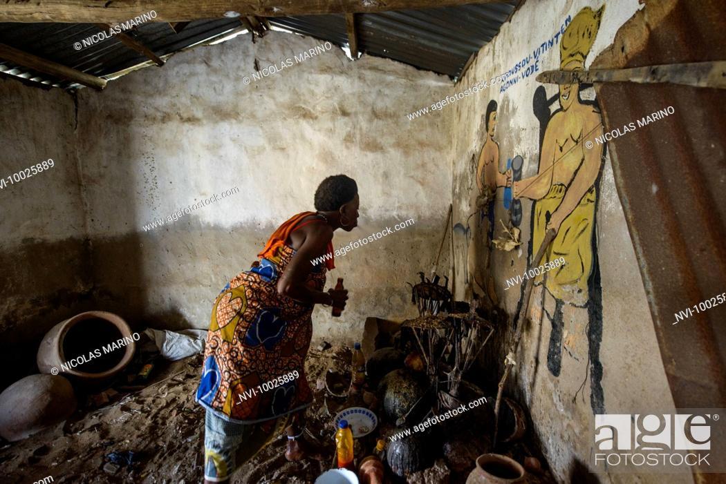 A voodoo priestess performing a voodoo ritual, Ganvié, Benin