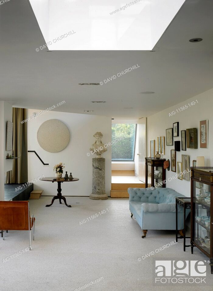 Stock Photo: Traditional furniture in modern house extension.