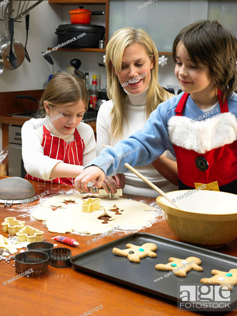 Stock Photo: Mother and children making cookies.