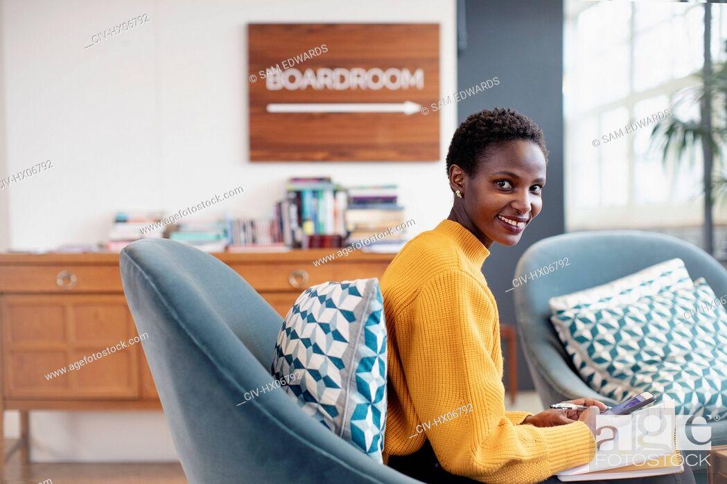 Stock Photo: Portrait confident businesswoman working in office.