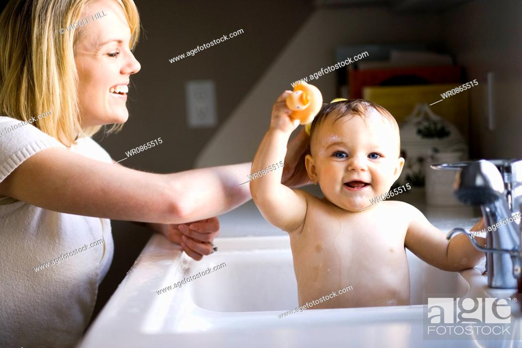Woman bathing baby in sink, Stock Photo, Picture And Royalty Free ...