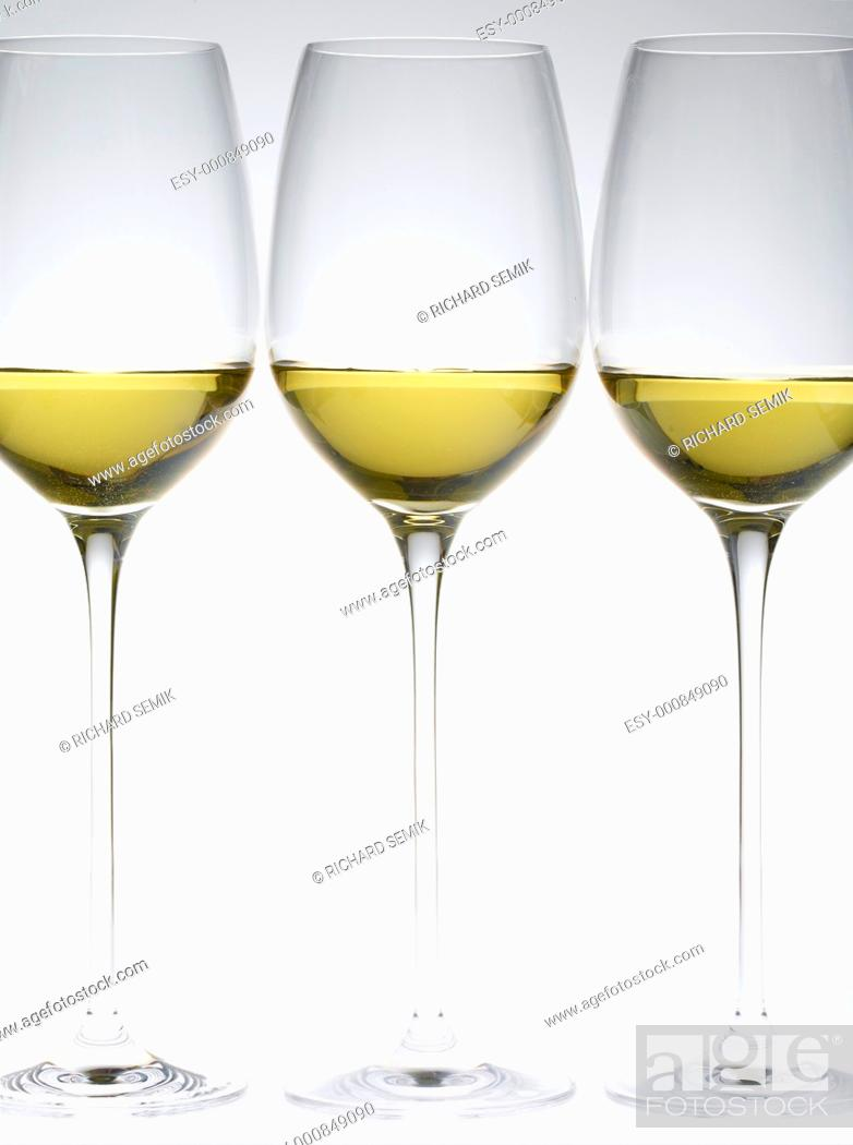 Stock Photo: wineglasses with white wine.
