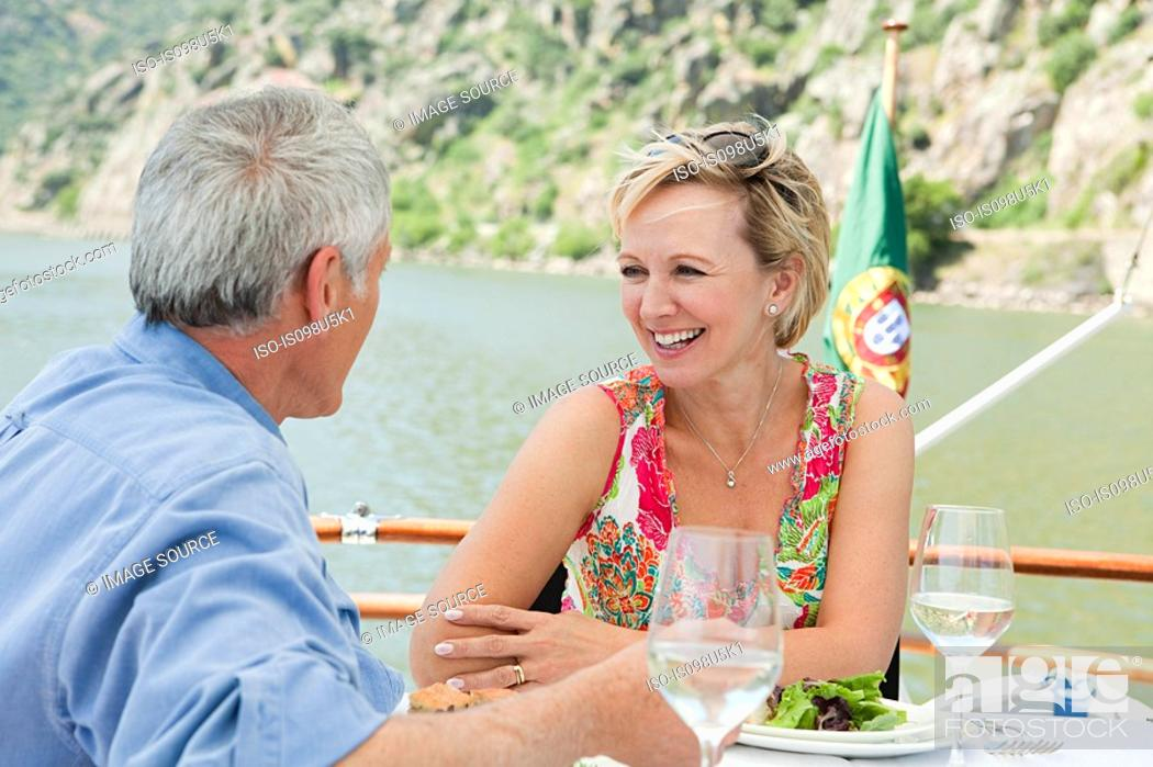 Stock Photo: Senior couple having lunch on a boat holiday.