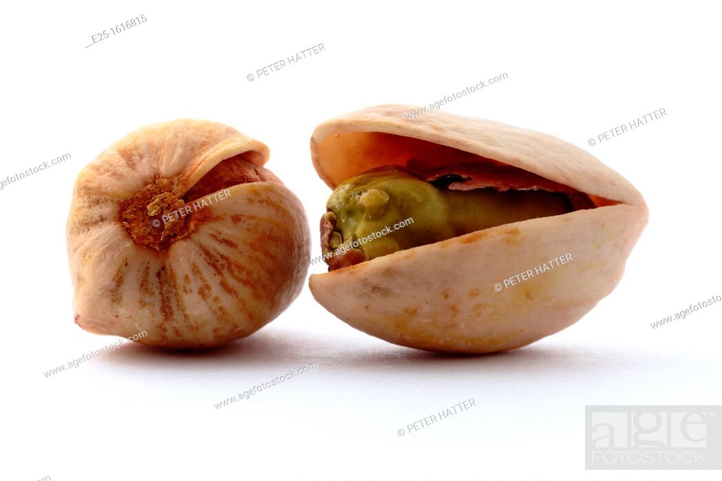 Stock Photo: Two pistachio nuts isolated on a white background.