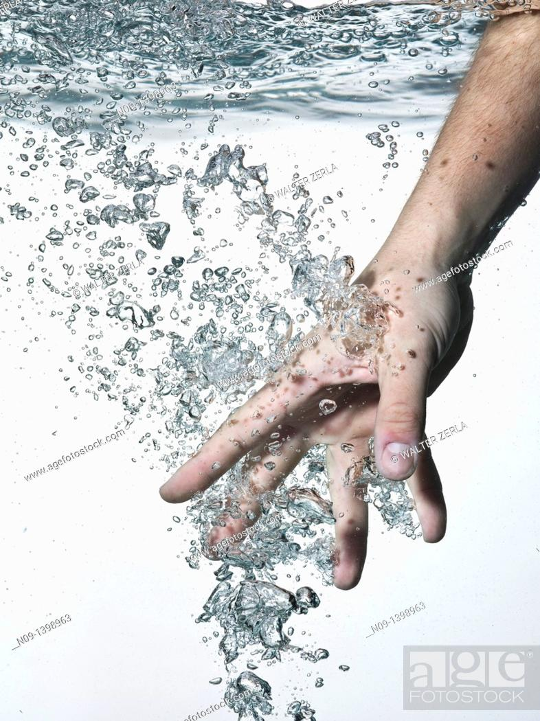 Stock Photo: Hand in water on a white background.