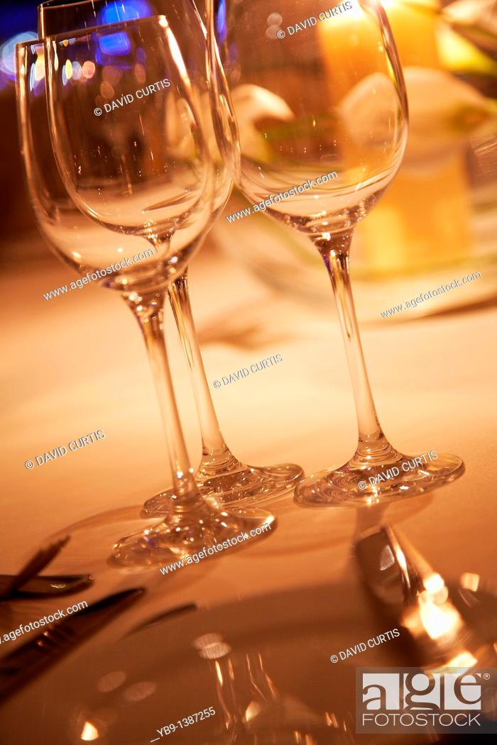 Stock Photo: evening table setting with Empty wine glasses.