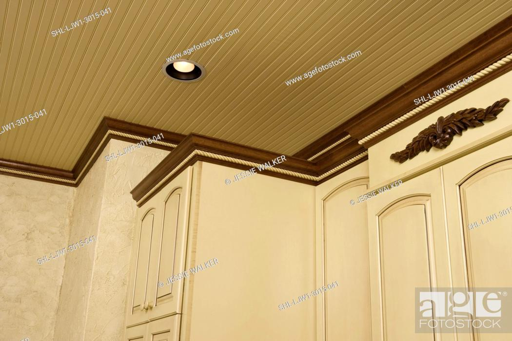 Stock Photo Architectural Trim Dark Stained Crown Molding With Yellow Painted Cabinets Wainscot Ceiling Angled View Many Diffe Levels Of