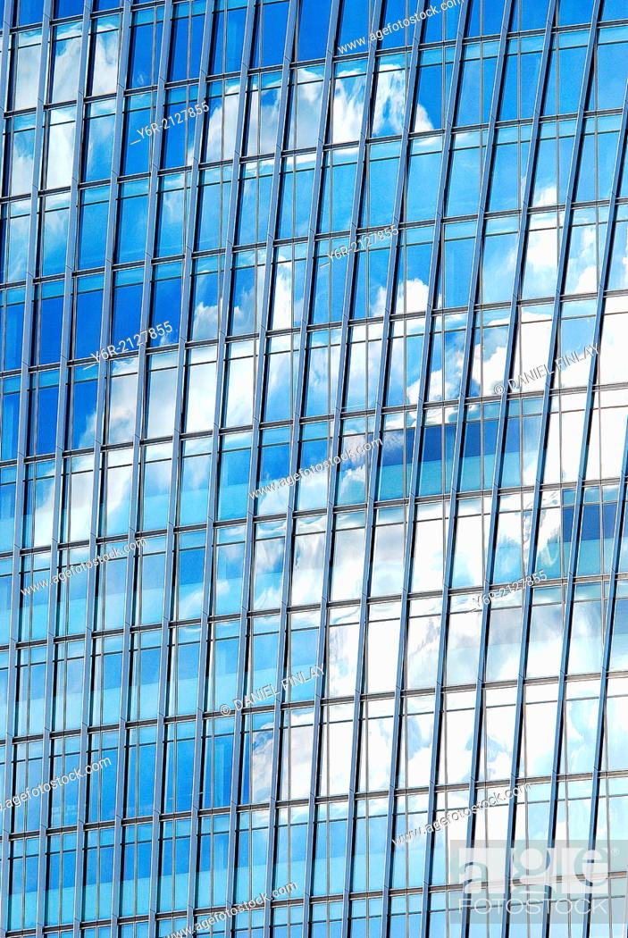 Stock Photo: Clouds reflected in a modern office building in Southwark, close to the Shard, in the heart of London, England.