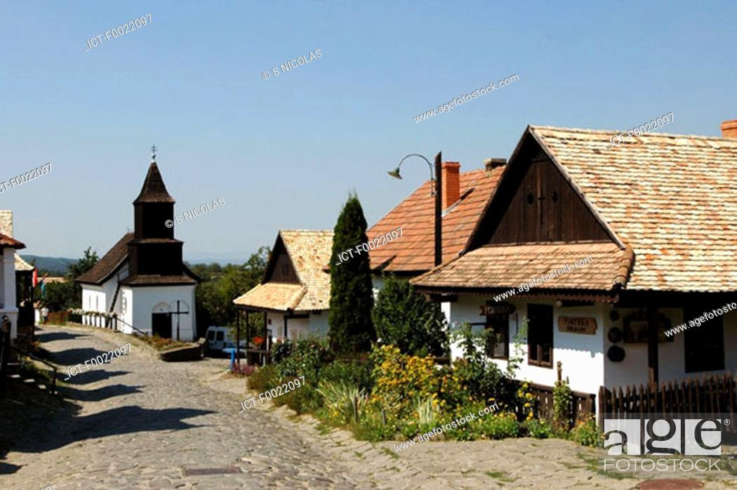 Stock Photo: Hungary, Hollok÷, traditional church and houses.