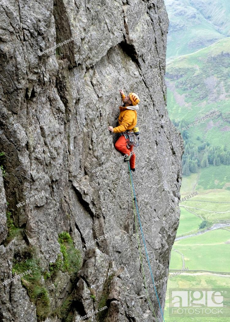 Stock Photo: United Kingdom, Lake District, Langdale Valley, Gimmer Crag, climber on rock face.